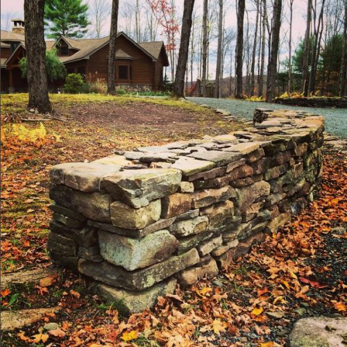 Freestanding fieldstone wall featured on a property in Chapin Estate, Bethel, NY.