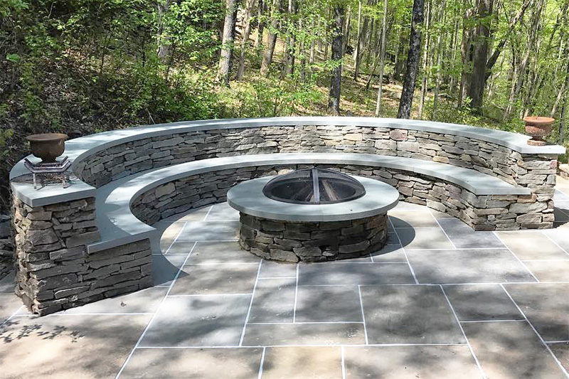 Circular stone outdoor firepit and seating, Roscoe, NY